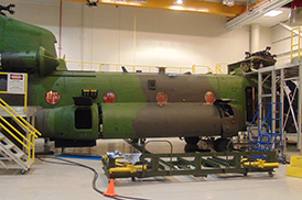 Image of Chinook fuel tank being removed from the aircraft.